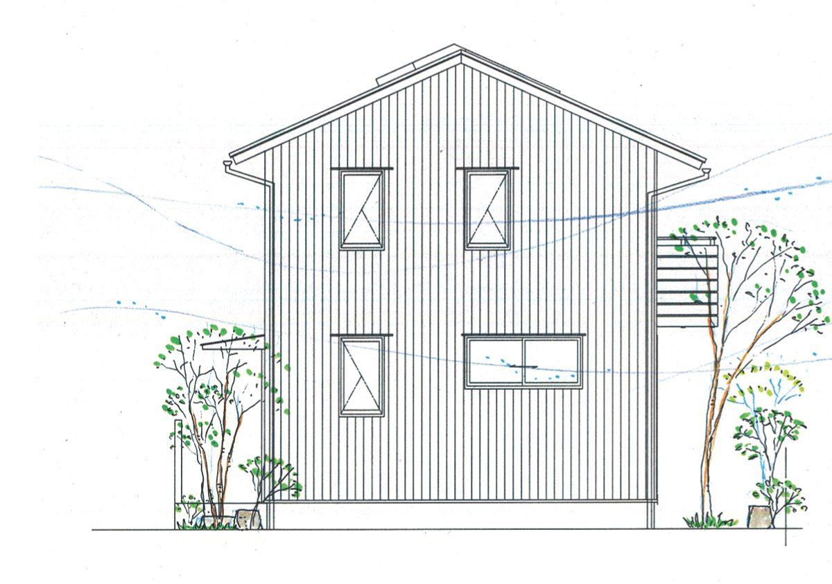 板張りの外壁と小林賢二さんの庭が印象的な外観